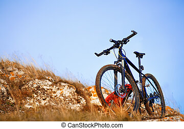 Mountain bike after ride in nature with backpack.