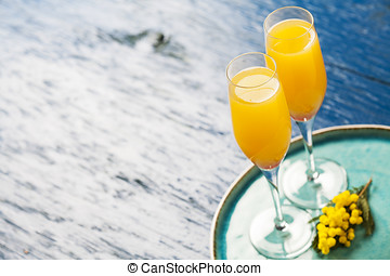 Mimosa cocktail - Two glasses with mimosa cocktail...