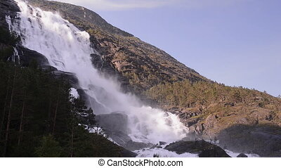 Picturesque waterfall Langfoss in Norway. National tourist...
