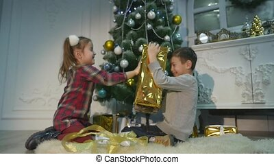 childrens unpack surprise for Christmas. The concept of holidays