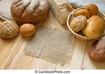 Fresh fragrant bread on the wooden table.