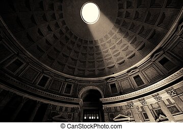 Pantheon interior with light beam in Rome, Italy.