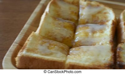 Toast with condensed milk and sugar - Toast topped with...