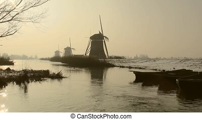 Windmills in Wintersun in Holland.