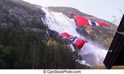 Picturesque waterfall Langfoss in Norway with Norwegian...
