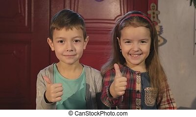 brother and sister together with giving a thumbs up of...