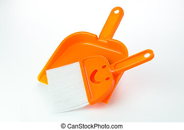 Broom and dustpan - Small orange broom and dustpan over...