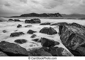 Rocky Coastline Black And White - A black and white rocky...