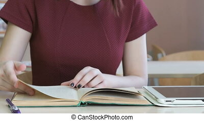 Student girl reads school textbook. Close-up