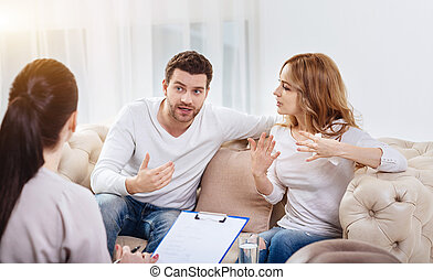 Emotional cheerless couple having a disagreement -...