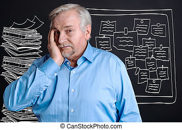 Unhappy stressful man having a heavy workload