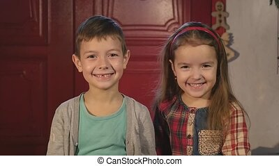 Little boy and girl laughing