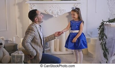 Little girl play with her dad . Christmas theme
