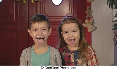 A little boy and girl laughing and hamming on camera