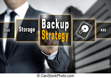 Backup Strategy touchscreen is operated by a businessman.