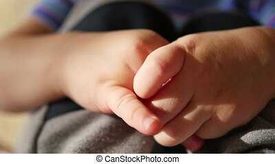 children's small hands closeup. macro - children's small...