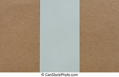 Blank white paper on brown cardboad background