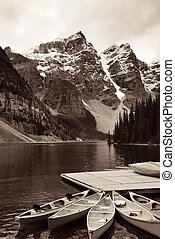 Moraine Lake with boat and snow mountain