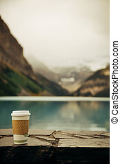 Banff National Park - Lake Louise with coffee cup in Banff...