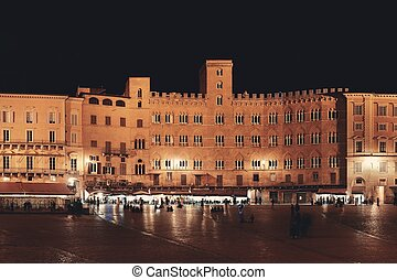 Piazza del Campo Siena Italy night - Old buildings in Piazza...