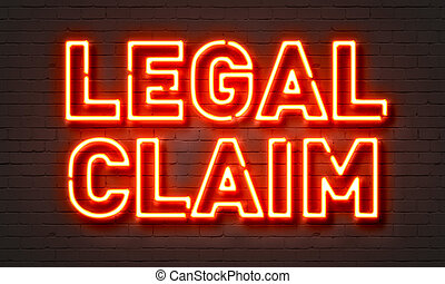 Legal claim neon sign on brick wall background. - Legal...