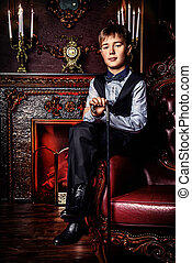 handsome kid - Handsome nine year old boy in elegant suit...