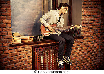 playing music - Handsome young man musician playing his...