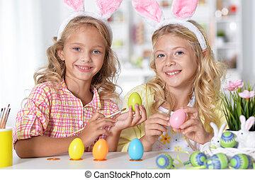 little girls painting easter eggs - little girls having fun...