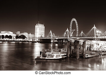 Thames River night view with office buildings, boat and...
