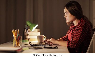 student or woman typing on laptop at night home - education,...