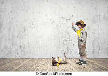 Happines - Smiling child with terrier in studio