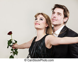 Enamoured couple in titanic gesture. - Love in air. Freedom...