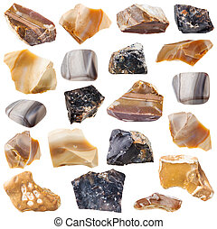 collection of tumbled and raw flint stones - collection of...