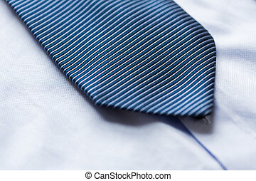 close up of shirt and blue patterned tie - clothing, formal...