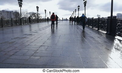 People walk on the bridge, in the afternoon. Timelapse. -...