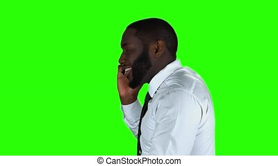 Phone call on chromakey background. Black man talking on...