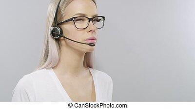 Smiling customer service or helpdesk woman with headset -...