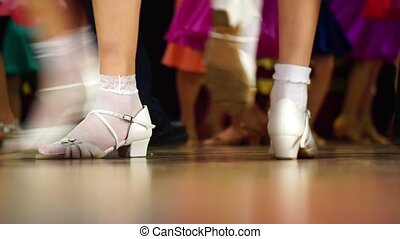 Background - children's tournament on ballroom dances - feet...