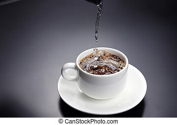 boiled water is poured into a white cup with black coffee