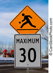 Playground Zone with Maximum Speed Limit Sign