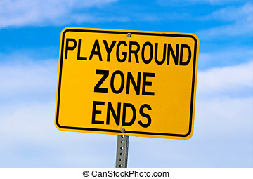 Playground Zone End Sign Against Blue Cloudy Sky