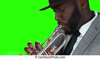 Trumpeter in a hat. Black man with a trumpet.
