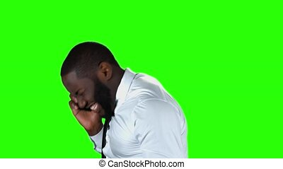 Phone talking on chromakey background. Happy man with raised...