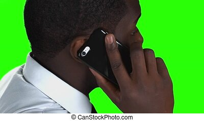 Phone talking on green background.