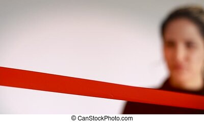 Confidant business woman cutting red ribbon - Woman cutting...
