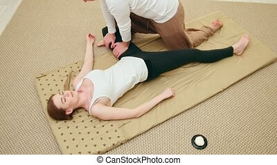 Thai massage - caucasian model female - stretch the muscles...