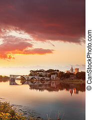 Avignon old bridge against colorful sunset in Provence,...