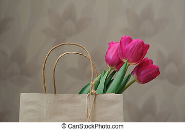 bouquet of red tulips in paper bag - bouquet of red tulips...