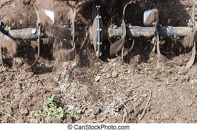 Loosens the soil cultivator close-up - Garden tiller to...