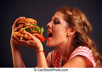 Girl opened her mouth, holding a hamburger on his...